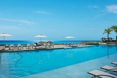 The stunning infinity pool at Secrets The Vine Cancun brushes up against the crystal clear waters of the ocean.