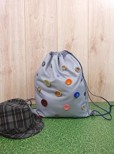 Grey Drawstring Bag with Buttons http://etsy.me/2ngYY4q #airyfairybags #bagsandpurses #backpack #gray #drawstringbag #fitnessrucksack #schoolsack #teensbag #womensbag #cinchbag, #festival, #buttons, #style, #strange, #cool, #unusual, #backpacks, #kidsbag, #kidsbackpack, #bags, #etsy