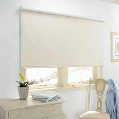 Blinds.com Gallery - Available in a wide assortment of materials and colors that include solid colors and jacquard woven fabrics. Shown in Rockport Pearl White.