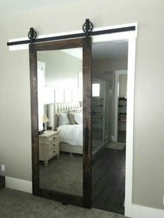 I love barn doors. And the mirror  gives the illusion that the room is bigger.