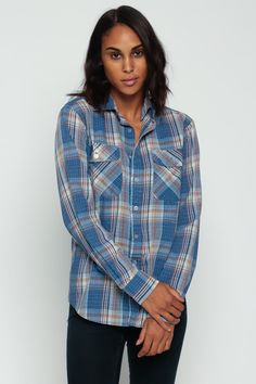 """Vintage 70s shirt in a blue, white and brown plaid print. It has chest pockets, a pointed collar, long sleeves & buttons up the front. Unisex.  Every item we sell is authentic vintage and one-of-a-kind! You will receive the EXACT item shown in the photos. For reference, model is 5'8"""" and measures 32-23-34. DETAILS  Best fits: marked small (Note: We only have ONE in stock. If more than one size is listed it is because this item will work on a range of sizes. Check measurements for exact fi..."""