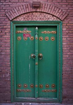 Painted green door in Kashgar Old Town, China Kashgar Old City, Xinjiang, China