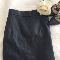 """NWT Black Leather Pencil Skirt Gorgeous, supple black leather in a classic  pencil skirt. Back snap and zipper. Waist measures 12.25"""" laying flat, a hair over 22"""" long. Trina Young Skirts Pencil"""