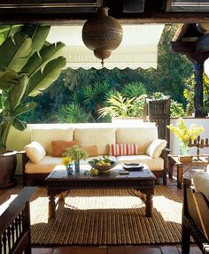 Tropical patio, love the light, plants, furniture...the view.