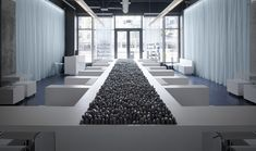 Google Image Result for http://static.dezeen.com/uploads/2008/07/mizu-spa-by-stanley-saitowitz-rocks.jpg  - Love the black rocks