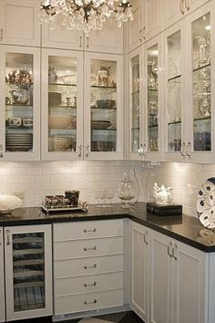 Glass cabinet doors and chandelier South Shore Decorating Blog: Themeless Thursday With Lots of Beautiful Rooms