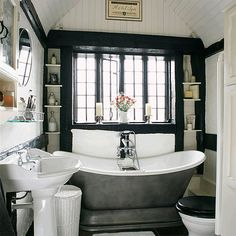 Small monochrome period bathroom. This compact en-suite bathroom adheres to a strict black and white colour code, and the luxurious Imperium Plinth bath from The Albion Bath Company and carefully chosen accessories complement original period features like the tongue and groove domed ceiling. #bathroom #toilet #shower