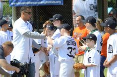 Miguel Cabrera gives high-fives to kids at a Miracle League of Michigan event.
