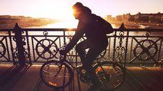 Bike rider on bridge sun rise