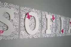 cute if new baby is a girl.  letters hung on diecut scrapbooking paper from joannes. with pink butterfly stickers.   easy peasy