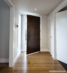 The copper paneled front door is a striking feature. The entranceway is painted in Resene Quill Grey, with trims in Resene Quarter White Pointer. Neutral Paint, Neutral Palette, Main Entrance Door, Main Colors, Colours, Wall Paint Colors, Wall Treatments, Grey Walls, Glass Door