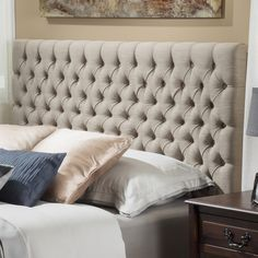 Add a luxurious focal point to the most important room in your home with the Jezebel adjustable King / California King fabric headboard.