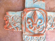 Turquoise Fleur-de-Lis Cross #inspiration #faith #scroll #stamped #art #homedecor #wallhanging #ranchhome #crosses #handmadecrosses #clay #ceramic #hope  SOLD