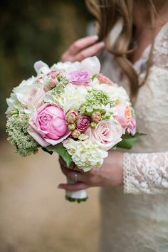 Romantic vintage inspired bridal bouquet with roses and hydrangeas