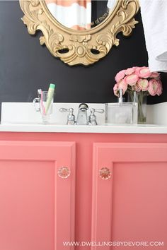 Girls bathroom? Love that cabinet painted pink!