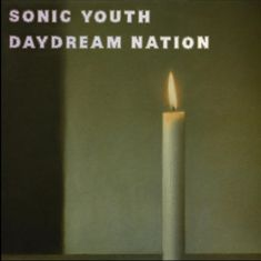 Sonic Youth – Daydream Nation: A section of the painting 'Kerze' by German artist Gerhard Richter, who was known for his photorealistic works. The original was auctioned by Sotheby's in 2008 with a guide price of £2.5m, but it sold for £7.1m.