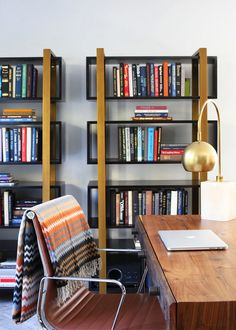 Midcentury modern home office and library with bookshelves | Usual House