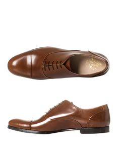 MR HARE Miller Lucida Oxford shoes Brown high-shine leather Oxford shoes with round-toe and lace-up front. Handmade in Tuscany, these Oxford shoes from Mr. Hare exemplify the luxury for which 'Made in Italy' is renowned. Mismatch this exquisite pair with navy and grey tailoring for a hint of nostalgia.