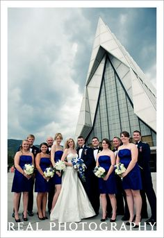 air force academy chapel wedding usafa military wedding party portrait outside blue bridesmaid dresses colorado springs photographer