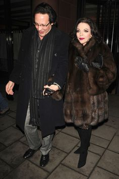 Joan Collins and Percy Gibson Photos: Joan Collins and Percy Gibson Leave C London