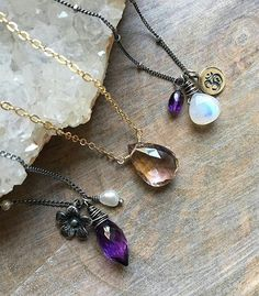#Repost @karinagracejewelry Had to squeeze in some Amethyst and Ametrine pieces before February comes to an end! These are what I like to call vintage karina grace! The 1st and 3rd necklaces are pieces I used to make years ago but now have been tweaked. The floral charm Amethyst and pearl necklace now comes with three pearls wire wrapped asymmetrically onto one side of the chain (partially shown). The Om charm necklace off to the far right has also been revamped and now features a Rainbow…