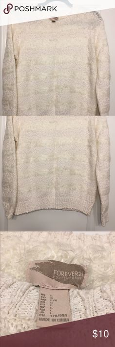 Forever 21 white/cream fluffy pullover Forever 21 white/cream fluffy pullover. It is a cream color with white fluffy stripes . Forever 21 Sweaters Cowl & Turtlenecks