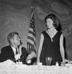 JFK applauds Jackie's remarks at a luncheon