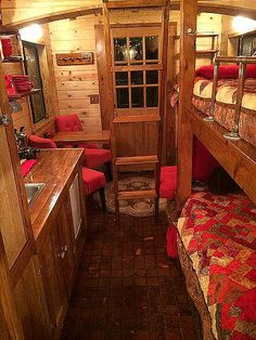 """This caboose tiny """"house"""" was built for a hotel, but it could accomodate two kids in bunkbeds and a couple upstairs. The cupola gives more headroom than a gabled roof. tinyhouseblog.com"""