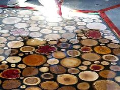 Spreading the epoxy over sanded wooden disks