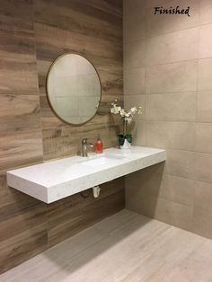 """Wow! Here's a look at our sleek new bathroom in Dallas, TX. We used our new Cemento Cassero Beige on the floor, Cemento Rosato Beige and Aequa Silva on the walls and the countertop is our new Della Terra Quartz- Pegasus! In case you forgot what it used to look like, I've included a """"before"""" pic.#AZTShowrooms #bathroomMakeover #DellaTerraQuartz https://arizonatile.com/"""