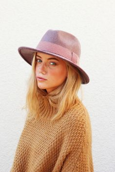 Fedora and camel sweater