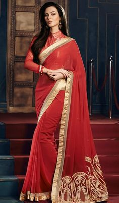 Look striking in this increase your admirers with this red color georgette embroidered sari. You'll see some fascinating patterns  done with lace, resham and stones work. Upon request we can make round front/back neck and short 6 inches sleeves regular saree blouse also. #TomatoRedPartyWearEmbroideredSari