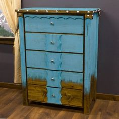 Rustic Domingo Azul Chest decorated with silver nail heads bordering the top edges as well as scalloped  raised wooden overlays on the drawers.   Western bedroom decor