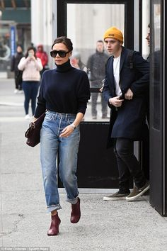 Making moves: Making their way to a runway show, the duo seemed in good spirits as Victoria lead the way on the outing