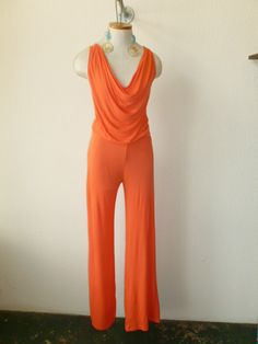 Cowl neck jumpsuit! Drape can be worn to the front or the back!