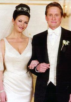 Michael Douglas and Catherine Zeta Jones, were both born on Sept. 25....he in 1944, and she in 1969. They married in 2000.