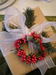 Christmas wrap bow and holly wreath. Repinned by www.mygrowingtraditions.com