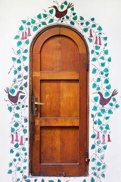 Birds and vines wind around the arched door of La Chascona, Pablo Neruda's home in Santiago, Chile.