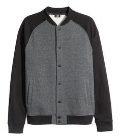 Dark grey baseball jacket in soft sweatshirt material with a stand-up collar and snap fasteners at front. Contrasting raglan sleeves, side pockets, and ribbing at cuffs and hem.   H&M For Men