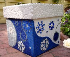 Blue and white flower pot  by Laura Leon Mosaics, via Flickr but do it in blacks tans grays