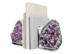 Modernity and nature combine in the design of RabLabs Fim Bookends. Striking variations of color differentiate the stones in these pieces. The gems are natural outgrowths from the inside of ancient lava streams, with traces of crystal, agate and amethyst.