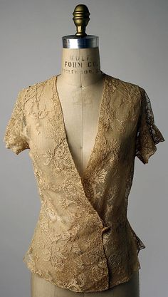 Pretty, but a rarely needed item here in Houston....Bed jacket Date: 1923–25