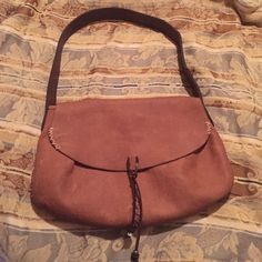 Lucky brand hobo shoulder purse. Used tan leather shoulder hobo purse. It has a few scuffs but still in nice condition, magnetic closure, zipper inside with two small card pockets inside. Lucky Brand Bags Hobos