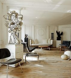 Parisian interior of Frederic Mechiche:Jean Dubuffet black and white sculpture (c.1960s), other artworks by Joseph Beuys, Pierre Soulages and Cesar & Jean Arp. Barcelona-lounge chair by Mies van der Rohe (1928) and a coffee table by Isamu Noguchi (1944).