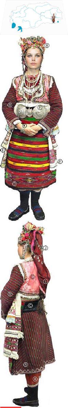 Bojmija young bride,beg. of the 20th c Gašti (long breeches); Košula (dress); Dulamka (waist-length garment); Anterija (long-sleeved overdress of woven cotton/silk); Pojas (sash); Krstaklija dipla (apron); Rizi (woven cloths);Puloi (large silver buckle); Eleče (short bodice); Fes (shallow hat), to which are attached Tepel'k (silver jewellery worn on the head) & (artificial flowers); the fes is covered w a Mumija (silk scarf) & Zadni obečki (decorative chains); Kolbi (large silver bracelets)