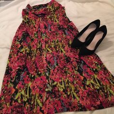 Lane Bryant Floral Dress This beautiful dress features an asymmetrical neckline. It's in perfect condition. Lane Bryant Dresses
