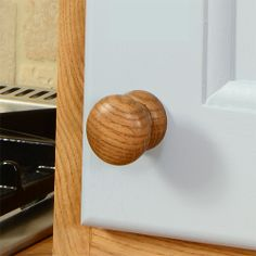 Oak's always been a firm favourite, and solid oak knobs such as this are no exception. Its stand-out grain patterns looks pretty darn great alongside a variety of coloured cabinets: http://www.deterra-kitchens.co.uk/kitchen_door_handles/solid-oak-knobs.html