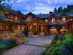 Romantic rustic log and stone home in a Colorado mountain village is part of Romantic Rustic home - This rustic lodge style home was designed by RMT Architects and built by Beck Building Company, located in Beaver Creek, Colorado Rustic Houses Exterior, Park Lodge, Beaver Creek, Log Cabin Homes, Log Cabins, Stone Houses, House In The Woods, House Plans, House Styles