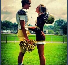 Cute football player and cheerleader