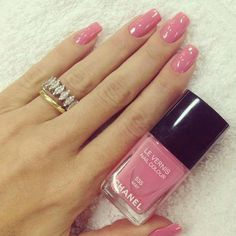 Nice shade of pink on perfectly-shaped nails and the rings are lovely, too!